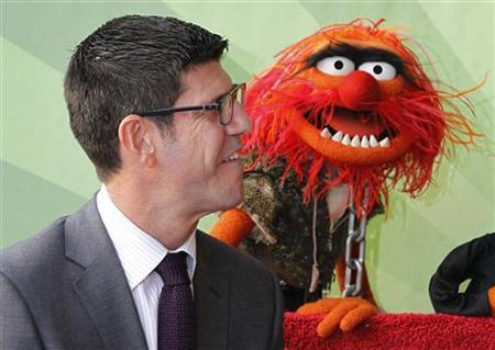 Chairman of Walt Disney Studios Rich Ross is pictured beside Muppets character Animal during ceremonies honoring the Muppets with a star on the Hollywood Walk of Fame in Hollywood, California March 20, 2012. REUTERS/Fred Prouser/Files