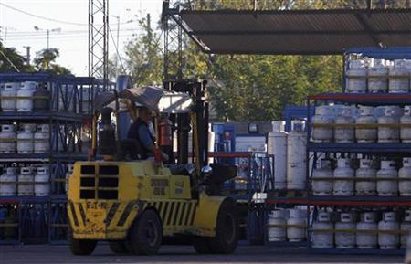 A worker operates a forklift truck inside a YPF Gas distributor in Moreno, Buenos Aires province, April 19, 2012. REUTERS/Marcos Brindicci