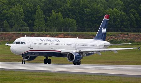 A US Airways jet prepares to take off in Charlotte, North Carolina April 20, 2012. REUTERS/Chris Keane