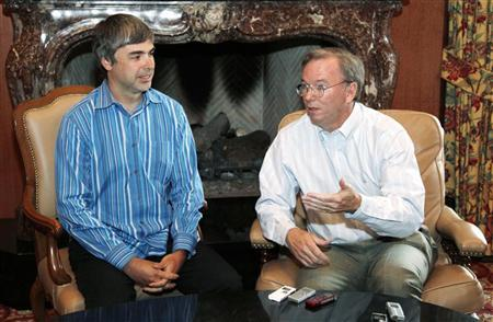 Larry Page, Google co-founder, listens as Google CEO Eric Schmidt (R) talks to reporters at the Sun Valley Inn in Sun Valley, Idaho July 9, 2009. REUTERS/Rick Wilking