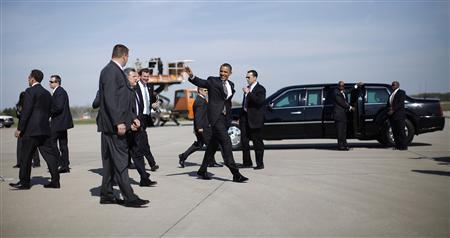 U.S. President Barack Obama walks among Secret Service Agents upon his arrival in Detroit, Michigan, April 18, 2012. REUTERS/Jason Reed
