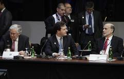 (L - R) Bank of England Governor Mervyn King, Britain's Finance Minister George Osborne and U.S. Federal Reserve Chairman Ben Bernanke attend the G20 meeting during the spring International Monetary Fund (IMF)-World Bank meetings in Washington April 20, 2012. REUTERS/Yuri Gripas