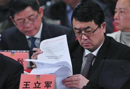 Deputy Mayor of Chongqing Wang Lijun reads documents as he attends a session of the Chinese People's Political Consultative Conference (CPPCC) of the Chongqing Municipal Committee, in Chongqing municipality, January 7, 2012. REUTERS/Stringer