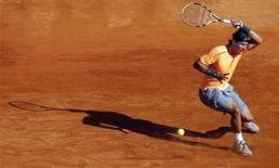 Rafael Nadal of Spain returns the ball to Gilles Simon of France during the semi-final of the Monte Carlo Masters in Monaco April 21, 2012. REUTERS/Eric Gaillard