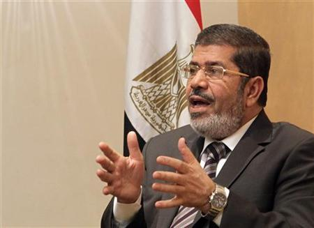 Mohamed Mursi, the head of the Muslim Brotherhood's political party, and the Brotherhood's new presidential candidate, talks during an interview with Reuters in Cairo April 21, 2012. Mursi, pitched into the race after the Brotherhood's first choice was disqualified, promised on Saturday to govern in coalition and to steady Egypt after more than a year of political turmoil. REUTERS/Asmaa Waguih