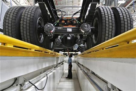 An employee inspects the engine of a BharatBenz truck inside Daimler's new factory in Oragadam in the Kancheepuram district of Tamil Nadu April 18, 2012. REUTERS/Babu