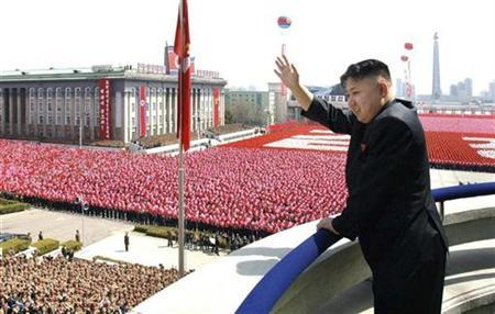 North Korean leader Kim Jong-Un waves his hand to the people during a military parade held to celebrate the centenary of the birth of the North's founder Kim Il-Sung in Pyongyang April 15, 2012 in this picture released by the North Korea's KCNA on April 16, 2012. Kim Jong-Un delivered his first major public speech on Sunday. REUTERS/KCNA