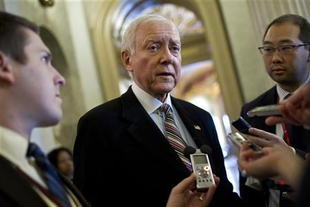 Senator Orrin Hatch talks to reporters during a series of votes in Washington December 17, 2011. REUTERS/Benjamin Myers