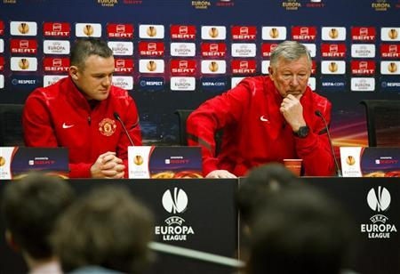 Manchester United's manager Alex Ferguson (R) and Wayne Rooney attend a news conference at the Amsterdam Arena stadium in Amsterdam February 15, 2012. REUTERS/Robin van Lonkhuijsen/United Photos