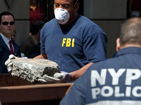FBI agents and New York City police officers remove concrete from a New York City apartment building where they were searching a basement for clues in the 1979 disappearance of Etan Patz, April 20, 2012. REUTERS/Keith Bedford