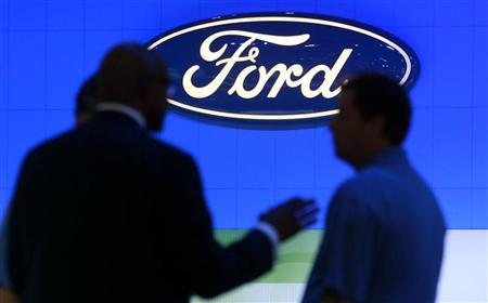 Men talk at the Ford exhibition as they attend the Washington Auto Show January 27, 2012. REUTERS/Kevin Lamarque