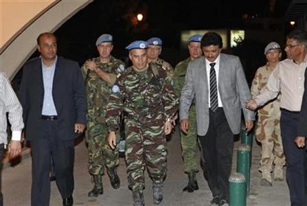 Moroccan Colonel Ahmed Himmiche (C) leader of the first U.N. monitoring team in Syria, arrives back at a hotel in Damascus after returning with his team from a visit to Homs city where there are protests against the regime of Syrian President Bashar al-Assad, April 21, 2012. REUTERS/Khaled al- Hariri