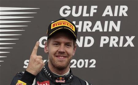 Red Bull Formula One driver Sebastian Vettel of Germany celebrates on the podium after winning the Bahrain F1 Grand Prix at the Sakhir circuit in Manama April 22, 2012. REUTERS/Darren Whiteside