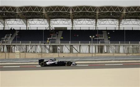 Williams Formula One driver Bruno Senna of Brazil drives by a mostly empty stand during the Bahrain F1 Grand Prix at the Sakhir circuit in Manama April 22, 2012. REUTERS/Steve Crisp