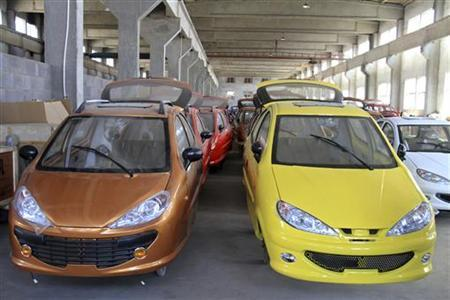 Bodies of electric cars are arranged inside a factory in Weihai, Shandong province, April 5, 2012. REUTERS/Stringer