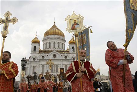 Members of the Orthodox clergy walk in procession after a call to prayer in support of the Orthodox Church at the Christ the Saviour Cathedral in Moscow April 22, 2012. REUTERS/Denis Sinyakov