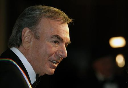 Singer, songwriter and 2011 Kennedy Center Honoree Neil Diamond speaks to reporters on the red carpet at the Kennedy Center for the gala performance for the 2011 Kennedy Center Honors in Washington, December 4, 2011. REUTERS/Molly Riley