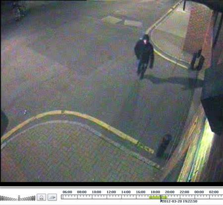 A suspected gunman is seen walking along Manilla Street in London on March 20, 2012 in this handout still image taken from CCTV released on April 23, 2012. British police released grainy photos on April 23, 2012 of a man suspected of shooting a former Russian banker near London's Canary Wharf financial district in a case that has raised fears that Russian gangland violence could be spreading to Britain. Financier German Gorbuntsov, 45, was shot five times as he entered a block of flats where he lives near the River Thames in the east of the capital on March 20. REUTERS/Metropolitan Police/Handout (BRITAIN - Tags: CRIME LAW)