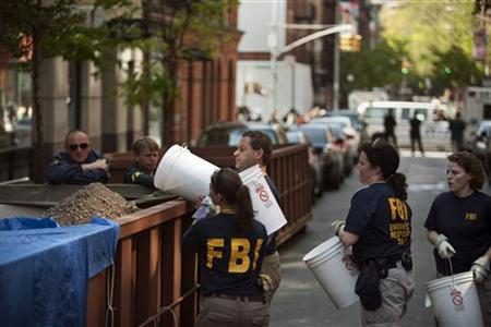 FBI agents and New York City police officers work at the scene of a New York City apartment building, April 21, 2012, where they were searching a basement for clues in the 1979 disappearance of Etan Patz. REUTERS/Allison Joyce