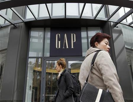 Pedestrians pass the Gap flagship store prior in San Francisco, California August 18, 2011. REUTERS/Robert Galbraith