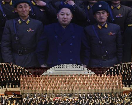 Footage of North Korea leader Kim Jong-un (C) standing with soldiers is shown during a concert in Pyongyang April 16, 2012. REUTERS/Bobby Yip