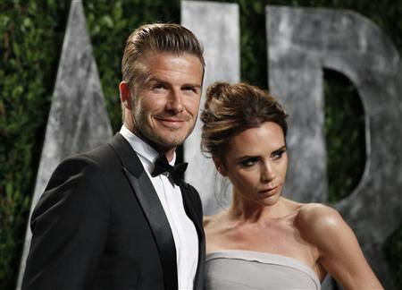 Soccer player David Beckham and his wife Victoria Beckham arrive at the 2012 Vanity Fair Oscar party in West Hollywood, California February 26, 2012. REUTERS/Danny Moloshok