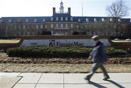 A woman walks past the Fannie Mae headquarters in Washington February 11, 2011. REUTERS/Molly Riley/Files