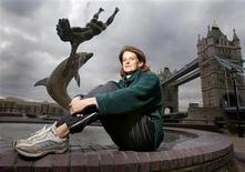 Zola Budd-Pieterse relaxes in front of Tower Bridge in London before making her debut in the London Marathon, April 11, 2003. REUTERS/Toby Melville