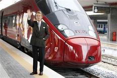 "Luca Cordero di Montezemolo, president for the NTV, waves as he poses in front of the new high-speed train ""Italo"" at the Naples central station, April 20, 2012. REUTERS/Max Rossi"
