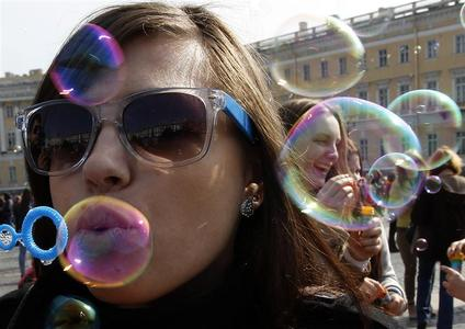 Participants take part in a soap bubble festival in the Palace Square in St.Petersburg April 22, 2012. REUTERS/Alexander Demianchuk