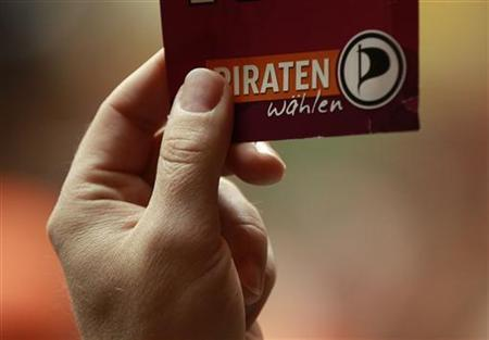 A delegate shows a voting card during an extraordinary meeting of the Pirate Party (Piraten Partei) in Dortmund April 15, 2012. REUTERS/Ina Fassbender