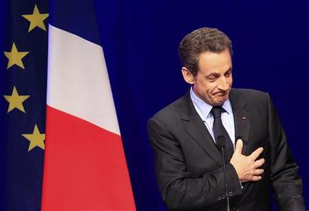 France's President and UMP party candidate for the 2012 French presidential elections Nicolas Sarkozy speaks to supporters at La Mutualite meeting hall in Paris after early results in the first round vote of the 2012 French presidential election April 22, 2012. REUTERS/Yves Herman