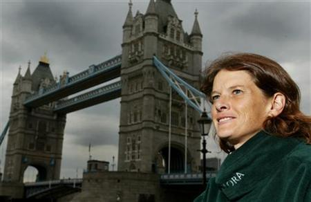 Zola Budd-Pieterse relaxes in front of Tower Bridge in London before running the London Marathon, April 11, 2003. REUTERS/Toby Melville/Files