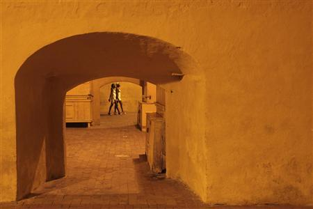 Prostitutes walk on the square of the old city in Cartagena in this picture taken April 17, 2012. As many as 21 women were brought back to a hotel in Colombia by U.S. Secret Service and military personnel in an incident last week involving alleged misconduct with prostitutes, U.S. Senator Susan Collins said on Tuesday. Picture taken April 17, 2012. REUTERS/Stringer
