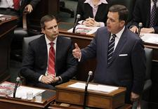 Ontario Premier Dalton McGuinty (L) looks on as Finance Minister Dwight Duncan delivers the provincial budget at Queens Park in Toronto, March 27, 2012. REUTERS/Mark Blinch