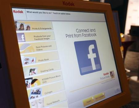 A Facebook logo is displayed on a Kodak photo kiosk during the 2012 International Consumer Electronics Show (CES) in Las Vegas, Nevada, January 11, 2012. REUTERS/Steve Marcus/Files