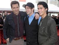 "Actors Peter Facinelli (L-R), Jackson Rathbone and Booboo Stewart pose as several cast members visit fans camping out for the premiere of ""The Twilight Saga: Breaking Dawn Part - 1"" in Los Angeles, California November 13, 2011. REUTERS/Jason Redmond"