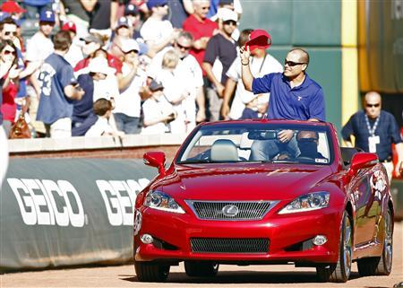 Ivan ''Pudge'' Rodriguez enters the field during a retirement ceremony before the start of the MLB American League baseball game between the Texas Rangers and the New York Yankees in Arlington, Texas April 23, 2012. Rodriguez, who played with the Rangers from 1991 to 2002, announced his retirement today after 21 years in the Major Leagues. REUTERS/Mike Stone
