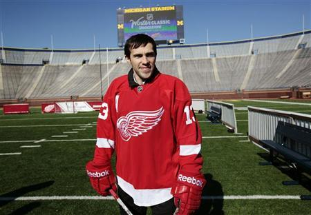 Detroit Red Wings player Pavel Datsyuk stands on the field at Michigan Stadium in Ann Arbor, Michigan February 9, 2012, following an announcement that the Red Wings will host the Toronto Maple Leafs at Michigan Stadium on the University of Michigan campus in the 2013 Bridgestone NHL Winter Classic. REUTERS/Rebecca Cook