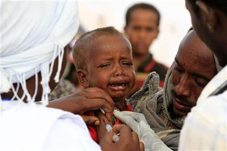 A newly arrived Somali refugee child cries as she receives a measles vaccine at the Ifo extension refugee camp in Dadaab, near the Kenya-Somalia border, August 1, 2011. REUTERS/Thomas Mukoya/Files