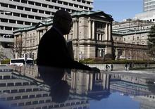 A man walks past the Bank of Japan headquarters building in Tokyo March 13, 2012. REUTERS/Yuriko Nakao