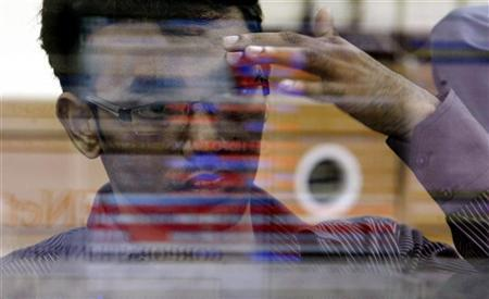 A broker reacts while trading at a stock brokerage firm in Mumbai October 6, 2008. REUTERS/Arko Datta/Files