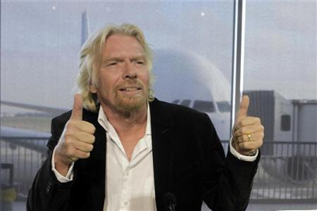 Sir Richard Branson, founder and president of Britain's Virgin Group, gestures after signing a contract for 60 Airbus A320 jets during the annual Airbus news conference at Colomiers near Toulouse January 17, 2011. REUTERS/Jean-Philippe Arles