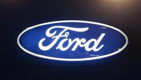 The Ford Motor Company logo is seen on a wall at the Qatar International Motor Show in Doha, January 27, 2012. REUTERS/Fadi Al-Assaad