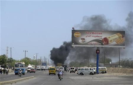 Smoke rises from the site of a bomb attack on the car of Brigadier Abdul-Qader al-Shami, the head of Political Security agency, in the southern Yemeni province of Lahej April 24, 2012. REUTERS/Stringer