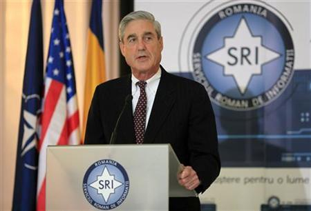 The FBI director Robert Mueller addresses a media briefing held together with the director of Romania's main secret service SRI George Maior (not pictured) in Bucharest, December 7, 2011. REUTERS/Radu Sigheti
