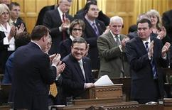Canada's Finance Minister Jim Flaherty is applauded after delivering his budget in the House of Commons on Parliament Hill in Ottawa March 29, 2012. REUTERS/Chris Wattie