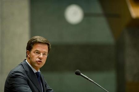 Prime Minister Mark Rutte reacts during a debate in the Dutch parliament about the government's resignation caused by a crisis over budget cuts in The Hague April 24, 2012. REUTERS/Robin van Lonkhuijsen/United Photos