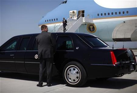 A U.S. Secret Service Agent holds the limousine door as U.S. President Barack Obama arrives at Cleveland Airport in Cleveland, Ohio April 18, 2012. Obama is in Ohio for an event on jobs and the economy and to Michigan for election fundraisers. REUTERS/Jason Reed
