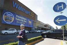 """A general view of a Wal-Mart store in Mexico City, April 24, 2012. Wal-Mart Stores Inc lost $10 billion of its market value on Monday on concerns that a bribery investigation in Mexico could be very costly and hinder its plans to grow. In a sign that the problem was widening for the world's largest retailer, two U.S. lawmakers said they were launching their own investigation into allegations in a New York Times article that Wal-Mart de Mexico had engaged in a multi-year campaign of bribery to build its business. In Mexico, the front-running presidential candidate, Enrique Pena Nieto, and lawmakers also called on local authorities to investigate. The banner reads, """"Low prices, every day, in everything"""". REUTERS/Edgard Garrido"""